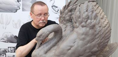 Man working on porcelain swan